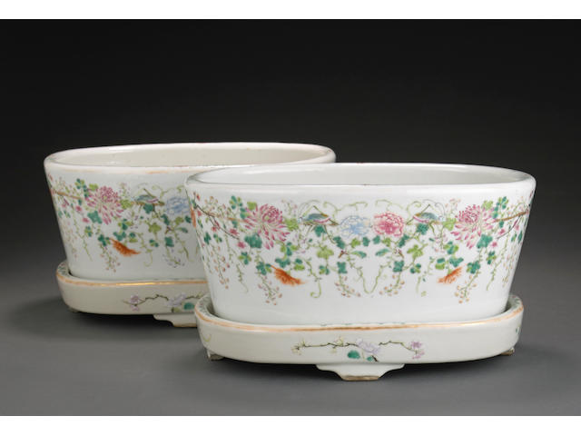 A pair of famille rose enameled planters and underdishes Hongxian marks, Republic period