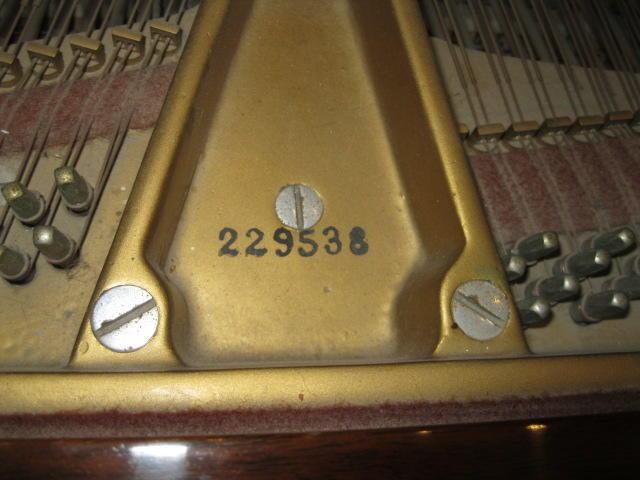 A Steinway & Sons walnut grand piano