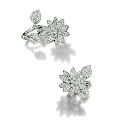 "A diamond and eighteen karat white gold ""Lotus between the finger ring"", Van Cleef & Arpels"