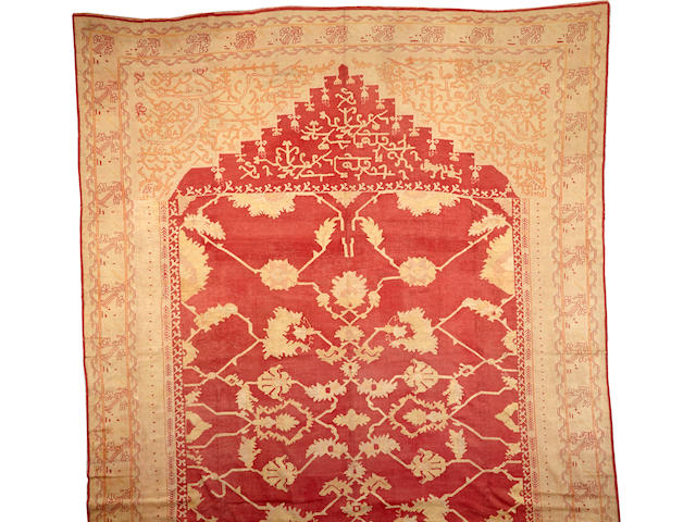 An Oushak carpet West Anatolia size approximately 14ft. x 22ft.