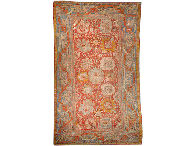 An Oushak carpet West Anatolia size approximately 11ft. 7in. x 19ft. 2in.