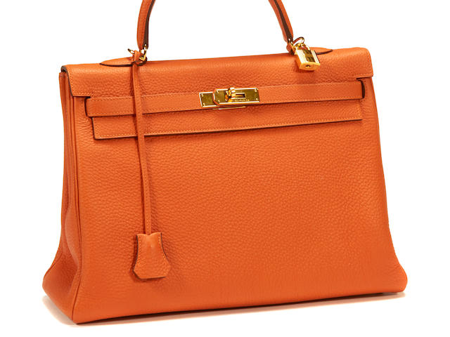 An Hermès orange leather Kelly handbag