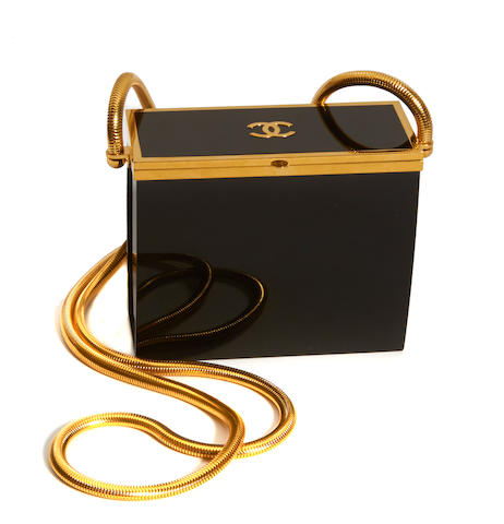 A Chanel gold-metal and lucite evening bag