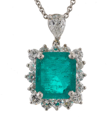 An emerald and diamond pendant with 14k white gold chain