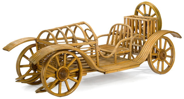 A large Rattan open seat car display, circa 1925, Approximately 92 x 30 x 30 ins.