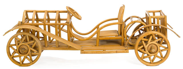 A small Rattan open seat car display, circa 1925, Approximately 75 x 23 x 24 ins.