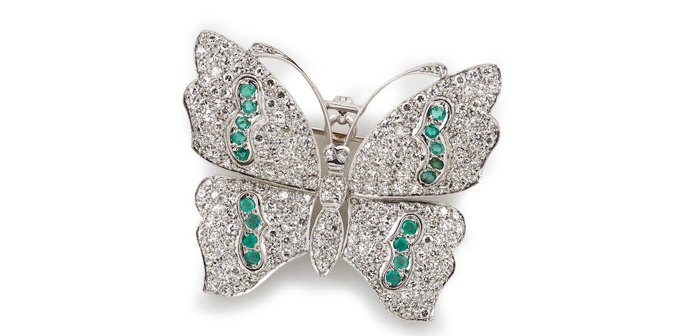 A diamond and emerald butterfly pendant-brooch