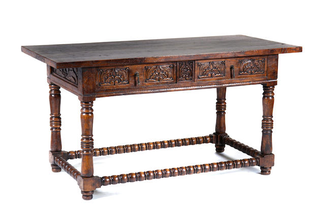 An Italian Renaissance style two drawer table