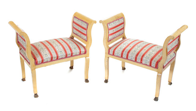 A pair of Empire style fruitwood and upholstered window seats