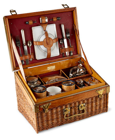 A Edwardian fully fitted picnic set for four in a fitted wicker case, by Drew & Sons, Picadilly Circus, London, early 20th century,