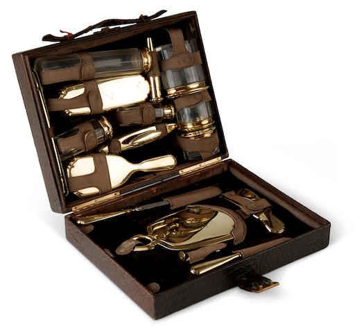 A sixteen piece 14K gold mounted toilet set in a fitted crocodile case by McA, early 20th century,