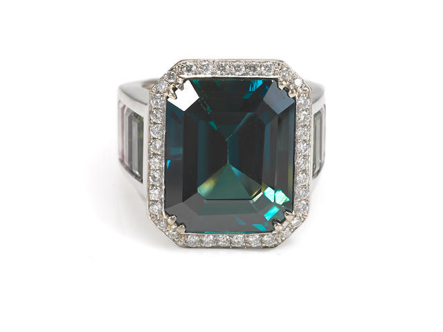 A green sapphire, vari-color sapphire and diamond ring