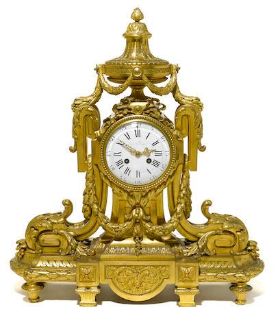 A Louis XVI style gilt bronze mantel clock