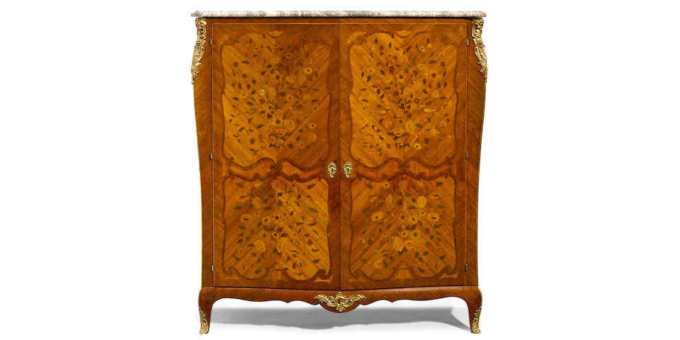 A Louis XV/XVI Transitional style gilt bronze mounted and marquetry inlaid side cupboard