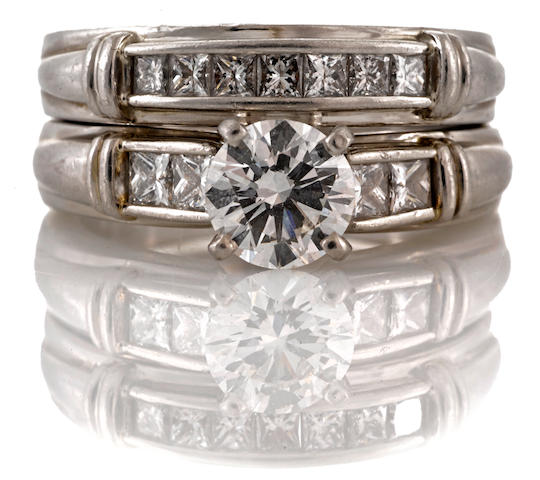 A diamond solitaire ring together with a matching band