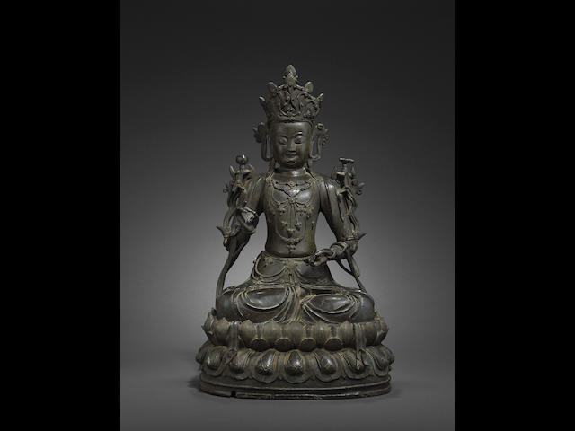 A fine cast bronze seated Buddhist deity 28in (71.2cm) high