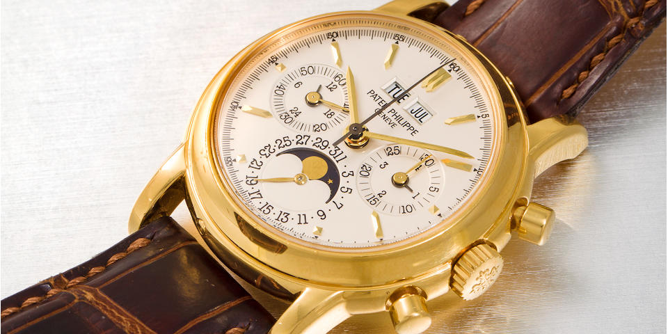 Patek Philippe. A fine 18K gold chronograph wristwatch with perpetual calendar and moon phaseRef:3970E, Movement No. 3046987, Case No. 4225171, Manufactured in 2001