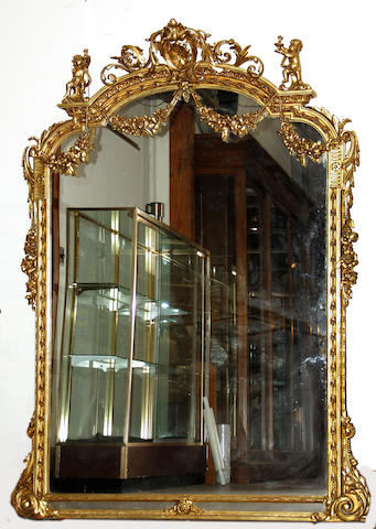 A Louis XV style gilt decorated mirror