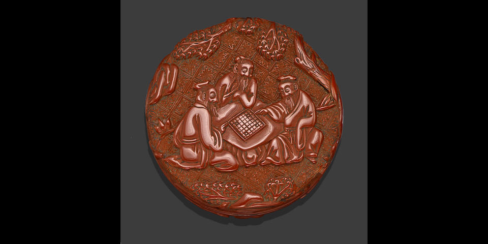 A rare carved cinnabar lacquer box with opposing figural and floral decoration Late Ming dynasty