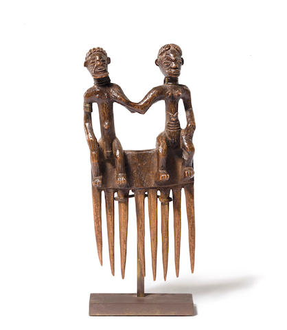 A Tchokwe comb with seated couple  Democratic Republic of the Congo