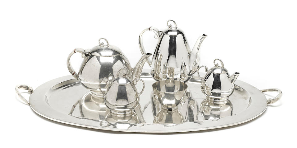 A Mexican  sterling silver  four-piece tea and coffee service with matching two-handled tray by Juventino Lopez Reyes,  mid-20th century
