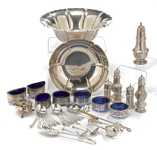 An assembled group of American and English sterling silver hollowware and flatware by various makers, including Cartier and Tiffany & Co., early 19th - 20th century