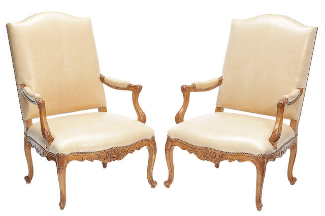 A pair of Rose Tarlow Louis XV style leather upholstered armchairs