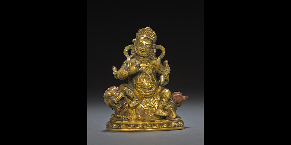 A gilt bronze seated figure of Vaishravana Tibeto-Chinese, 18th/19th century