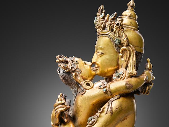 A gilt copper alloy figure of Vajradhara and Prajnaparamita Nepal or Tibet, 14th/15th century