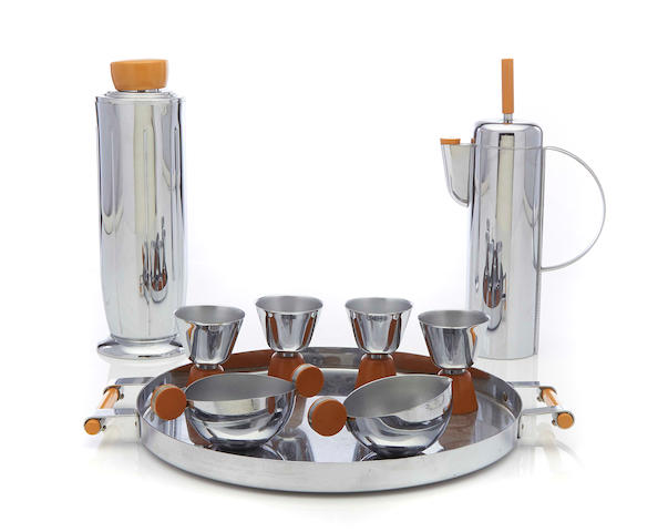 A Revere chromed metal and Bakelite Empire cocktail shaker and tray together with another shaker, four cocktail glasses and a sugar and creamer