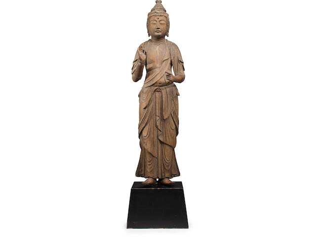 A standing wood figure of Kannon Nanbokucho period (14th century)