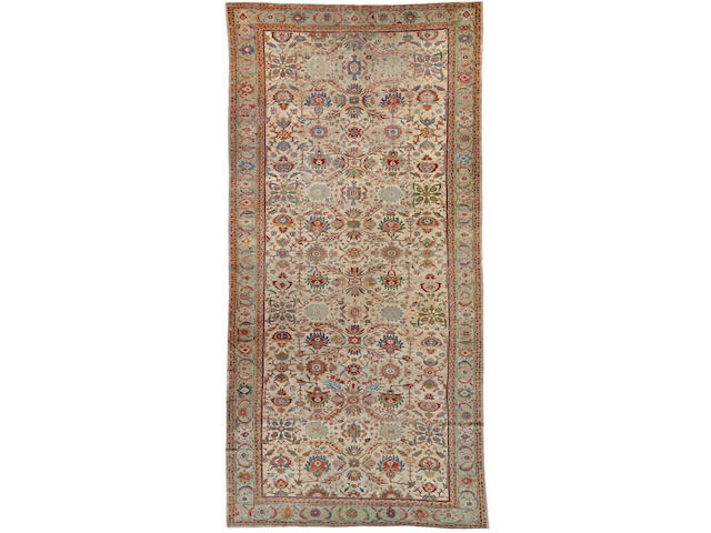 A Sultanabad carpet Central Persia size approximately 9ft. 8in. x 19ft. 7in.