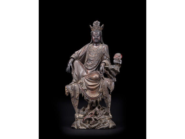 A large lacquered wood figure of Guanyin 18th century