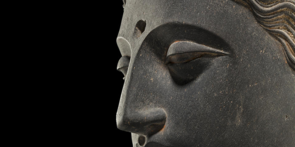 A carved schist head of Buddha Ancient region of Gandhara, 3rd/4th century