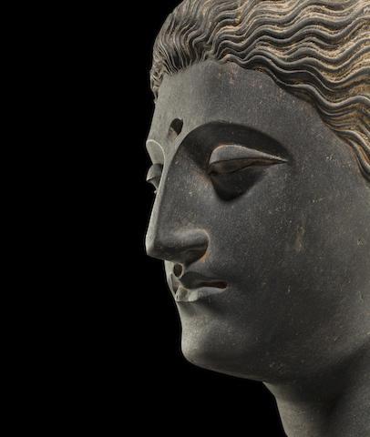 A carved schist head of Buddha Ancient region of Gandhara, 3rd/4th century