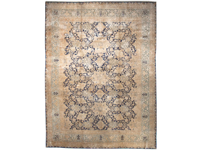 An Agra carpet  India size approximately 12ft. 2in. x 13ft. 2in.