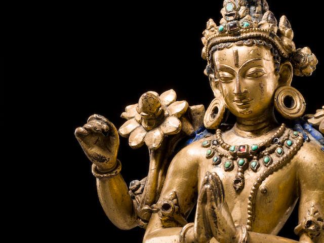 A gilt copper alloy figure of Avalokiteshvara Nepal, Khasa Malla region, 13th/14th century