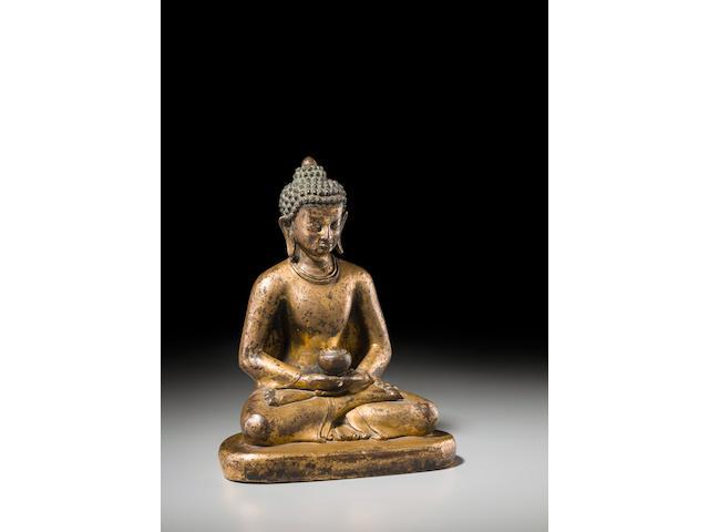 A gilt copper figure of Buddha Nepal, circa 13th century