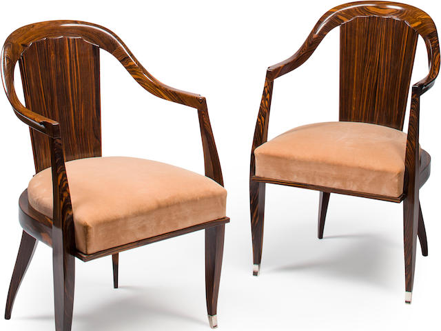 A pair of Emile-Jacques Ruhlmann macassar ebony and silvered bronze Cannelé armchairs Created for the Viville-Yardley Showroom, 24 avenue de l'Opéra, Paris, circa 1926