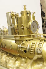 A rare silvered and gilt brass clockwork automaton model of a French armored cruiser Last quarter 19th century, Movement No. 9105, attributed to André Romain Guilmet