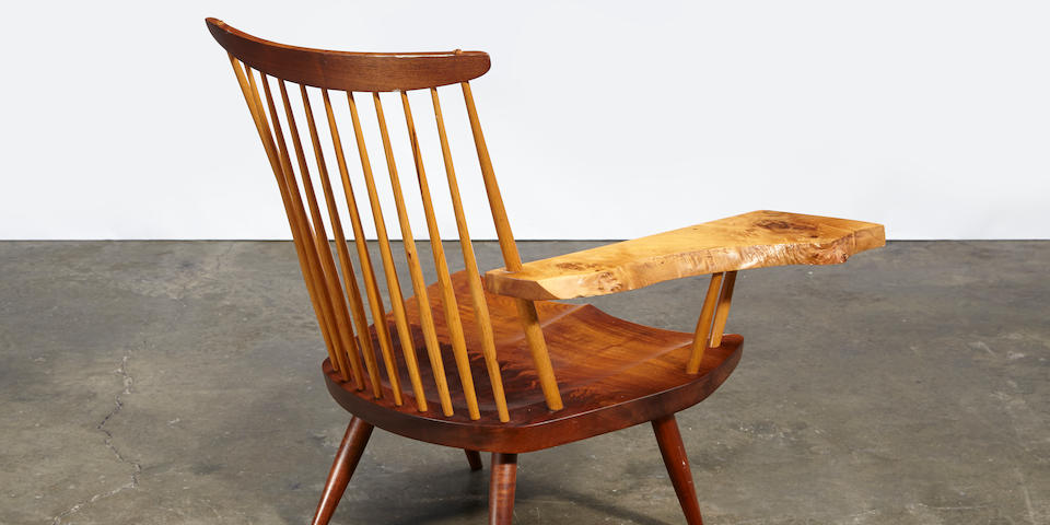 George Nakashima Lounge chair, One-Piece seat designed 1975, this example executed 1981, together with a copy of the original completion invoice dated 11/20/82, English walnut, American black walnut, hickory, signed 'George Nakashima', and with paper label stating 'Lounge chair One-Piece seat/English Walnut arm/Designed 1975/Made 1981'height 32 3/4in (83cm); width 24in (61cm); depth 22 1/2in (57cm)