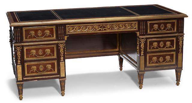 A Louis XVI style gilt bronze mounted mahogany bureau plat