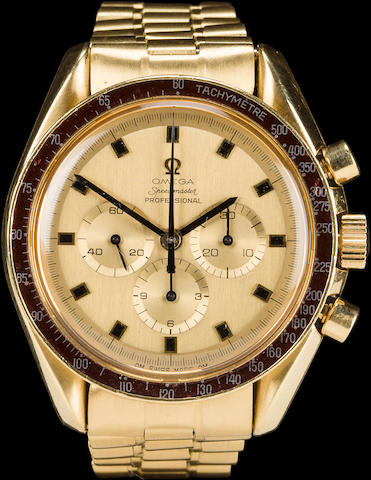APOLLO 12 ASTRONAUT ALAN BEAN'S LIMITED EDITION 18K GOLD OMEGA SPEEDMASTER PROFESSIONAL CHRONOGRAPH WRISTWATCH 18K gold chronograph wristwatch with wine-coloured bezel and Omega 18k gold bracelet. Number 26 of 30 given to President Nixon, Vice President Agnew, and the Apollo Astronauts.