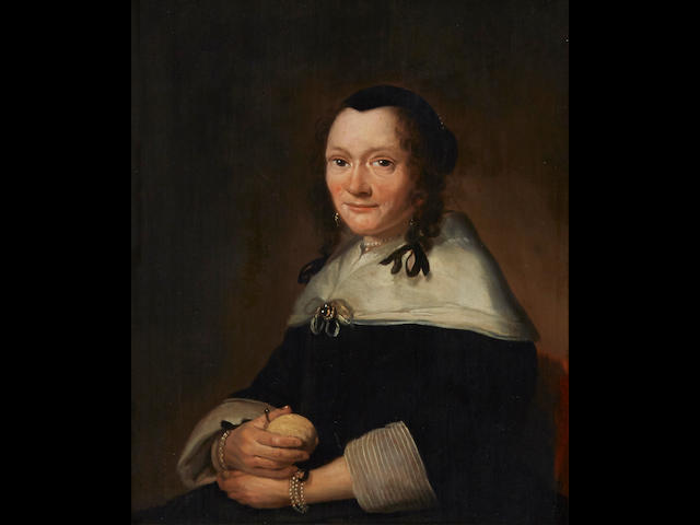 Follower of Johannes Cornelisz. Verspronck (Haarlem circa 1606-1662) A portrait of Admiral Jan Galen (1604-1653), seated, half-length, holding a staff; A portrait of his wife Maria van Cracou, seated, half-length, holding a lemon (a pair) 10 x 8 1/2in (25.3 x 21.6cm)