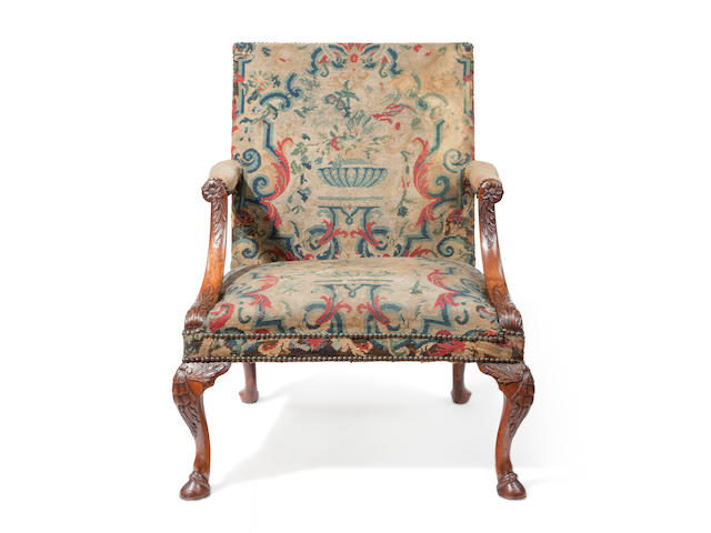 A George II carved walnut library armchair second quarter 18th century