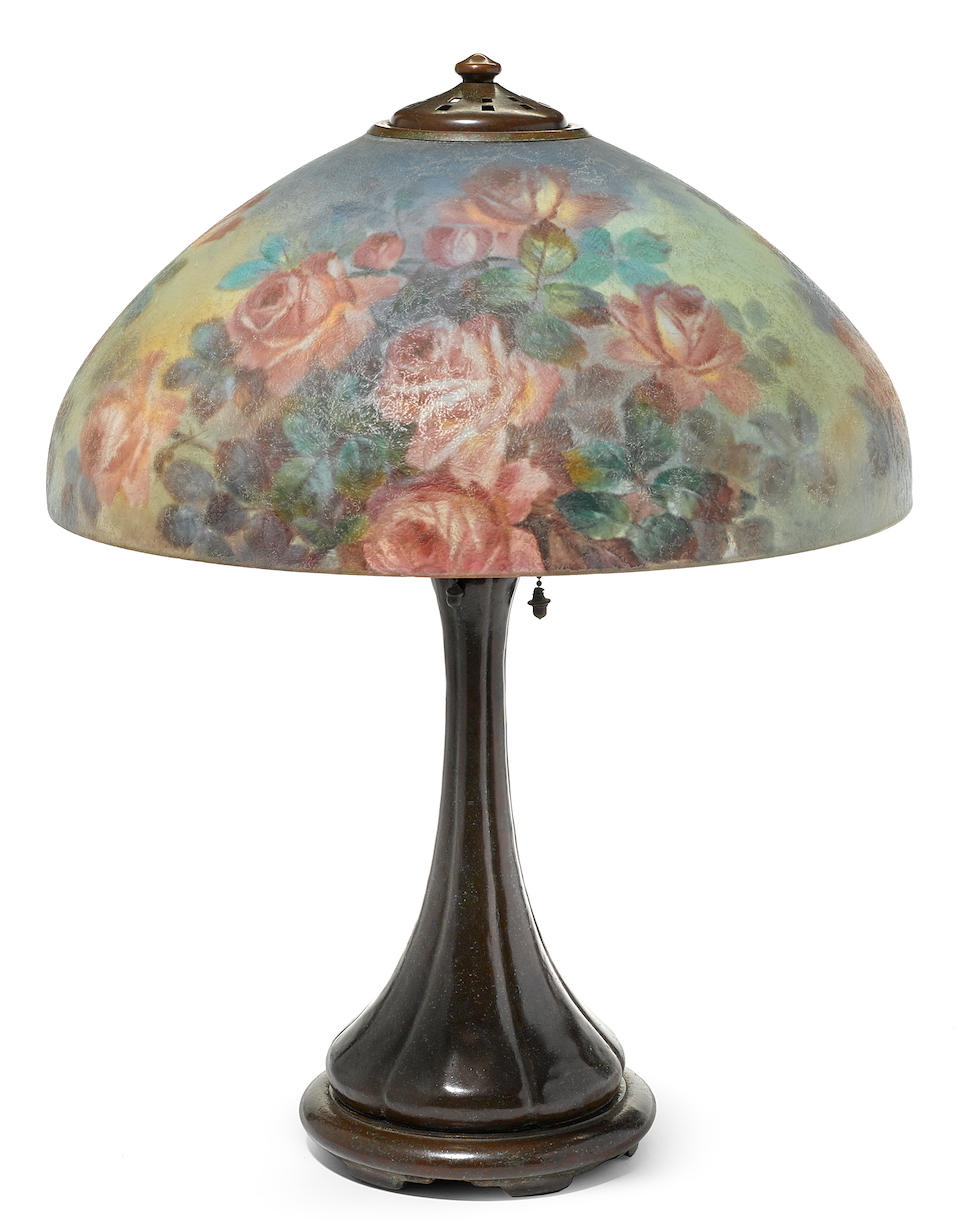 A Henry Bedigie for Handel reverse painted glass and patinated metal Roses table lamp circa 1920