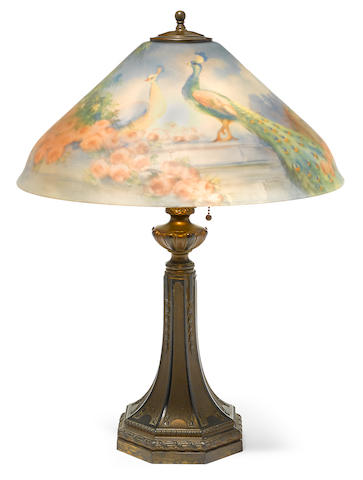 A Pairpoint reverse painted glass and patinated metal Two Peacocks on a Garden Wall table lamp 20th Century