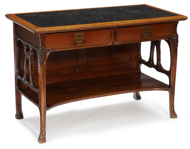 A French Art Nouveau carved mahogany and black marble buffet late 19th century