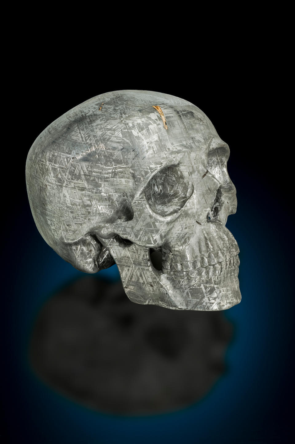 Bonhams Unique Life Sized Skull Form Carving Of A Gibeon Meteorite With Tridymite Inclusion By Lee Downey