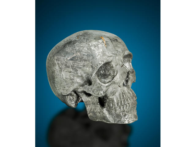 Unique Life-sized Skull-form Carving of a Gibeon Meteorite with Tridymite Inclusion By Lee Downey